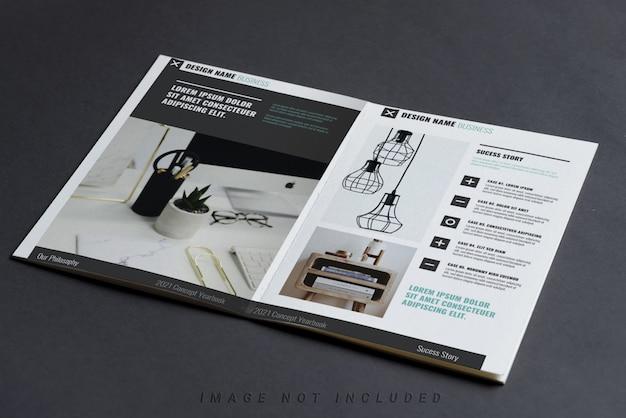 黒いテーブルに企業プロファイル小冊子モックアップ