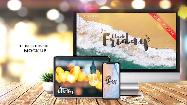 コンピューター画面、スマートフォン、デジタルタブレットの明るいショップテーブルのピクセル完璧なモックアップ
