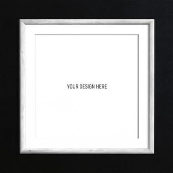 黒の織り目加工の壁に正方形の白い塗られた木製フレームモックアップ