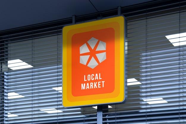 店舗の入り口に丸みを帯びた屋外ストリート都市垂直ロゴサインのモックアップ