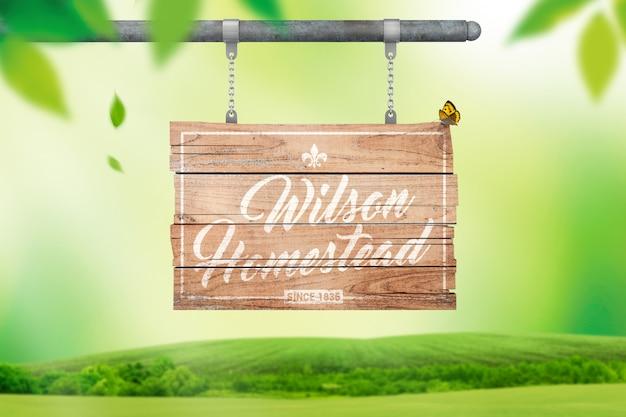 木製看板のモックアップに風化したロゴ