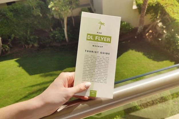 Рекламный флаер в руке макет