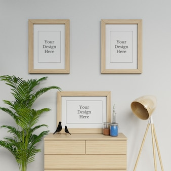 モダンな室内空間のプレミアムスリーa2ポスターフレームモックアップデザインテンプレート