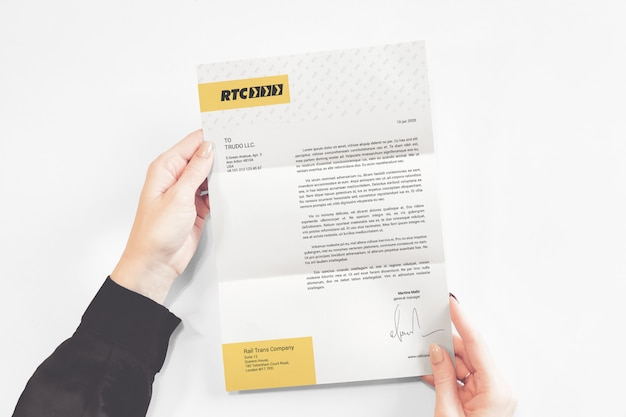 A4 letterhead in hands mockup