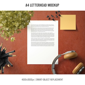 A4 letterhead mockup with headphones and plant