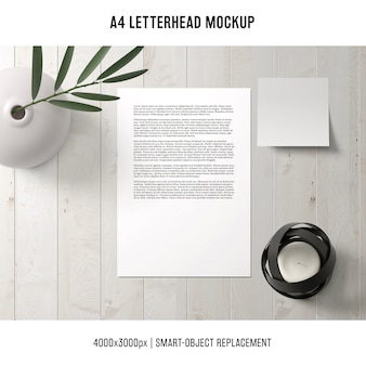 A4 letterhead mockup on wooden table