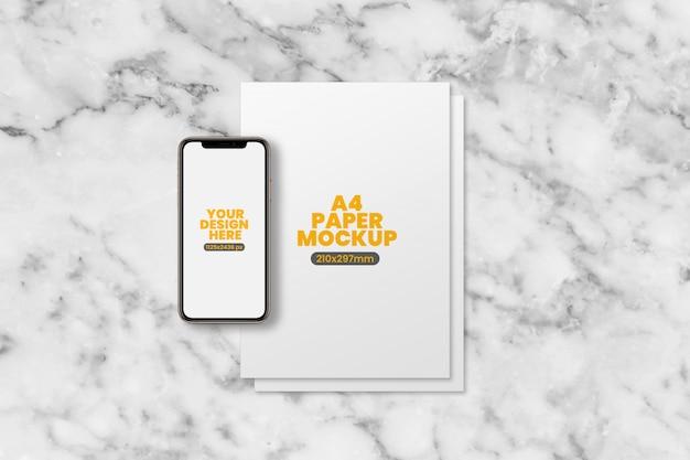A4紙とスマートフォンのモックアップ