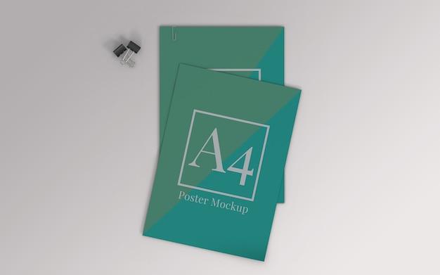 A4ポスターモックアップ、バインダークリップ、ペーパークリップの上面図