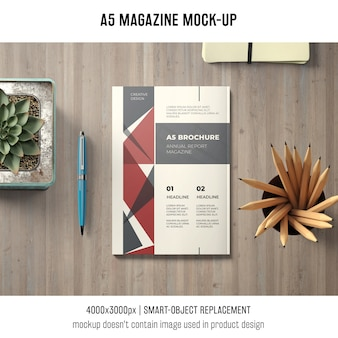 A5 magazine mockup on desk