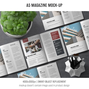 A5 magazine mockup with basil plant