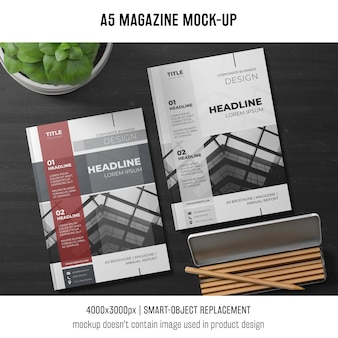 A5 magazine mockup with plant and pencils