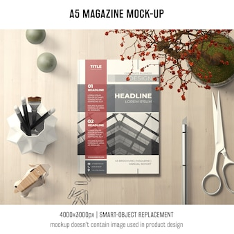 A5 magazine mockup with scissors