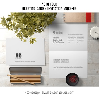 A6 bi-fold greeting card template with pencils and plant