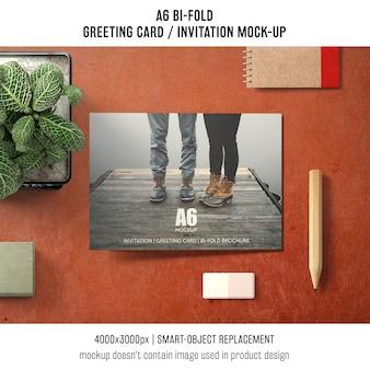 A6 bi-fold invitation card mockup design