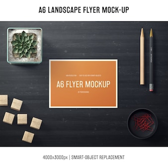A6 landscape flyer mock-up with plant