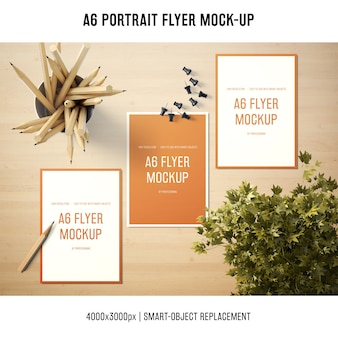A6 portrait flyer mock-up of three