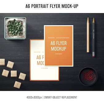 A6 portrait flyer mock-up with pencils