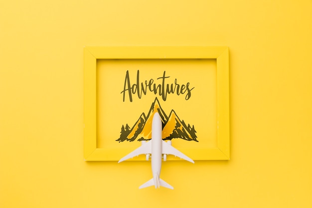 Adventures frame with mountain and airplane