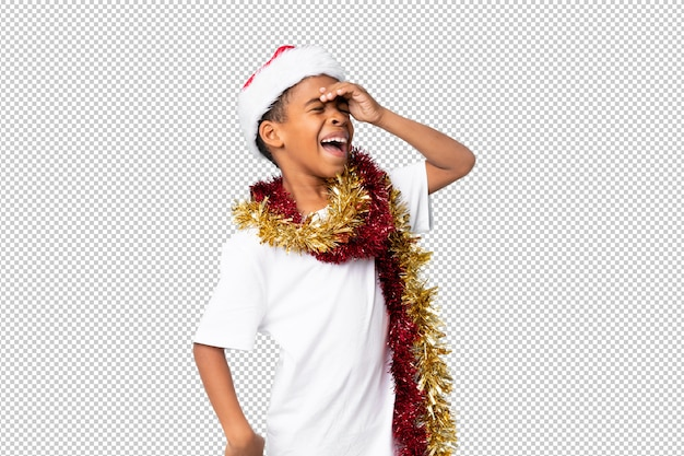 African american boy with christmas hat has realized something and intending the solution