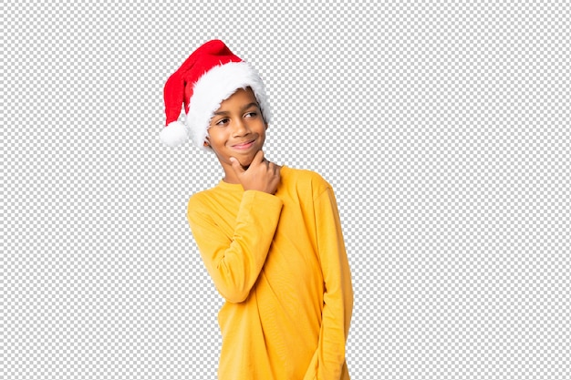 African american boy with christmas hat looking side