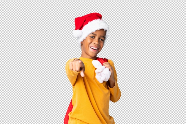 African american boy with christmas hat and pointing to the front