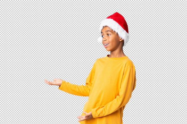 African american boy with christmas hat with surprise facial expression