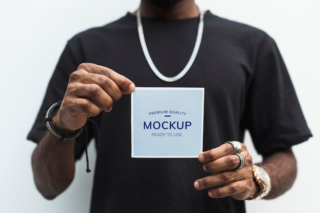 African man holding a photo paper mockup