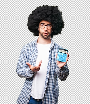 Afro young man holding a calculator