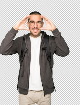 双眼鏡のように手を使って驚いた学生 Premium Psd