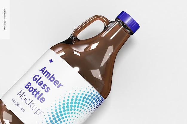 Янтарная стеклянная бутылка с ручкой мокап банка, крупный план