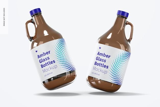 ハンドルジャーモックアップ付きの琥珀色のガラス瓶、落下