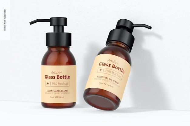 Янтарные стеклянные бутылки с мокапом насоса, перспектива