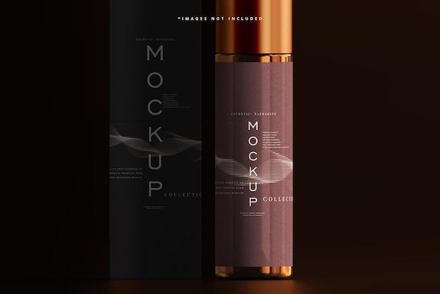 琥珀色のガラス化粧品ボトルとボックスのモックアップ