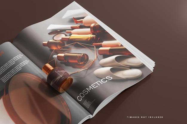 Mockup di flacone cosmetico e rivista in vetro ambrato