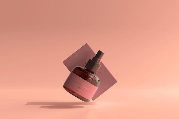 琥珀色のガラス化粧品スプレーボトルとボックスのモックアップ