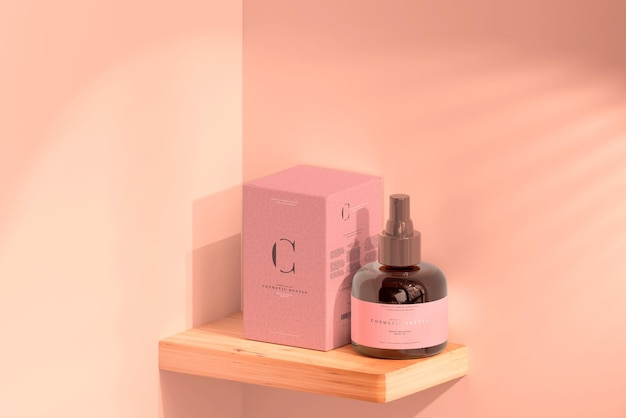 Mockup di flacone spray cosmetico in vetro ambrato e scatola