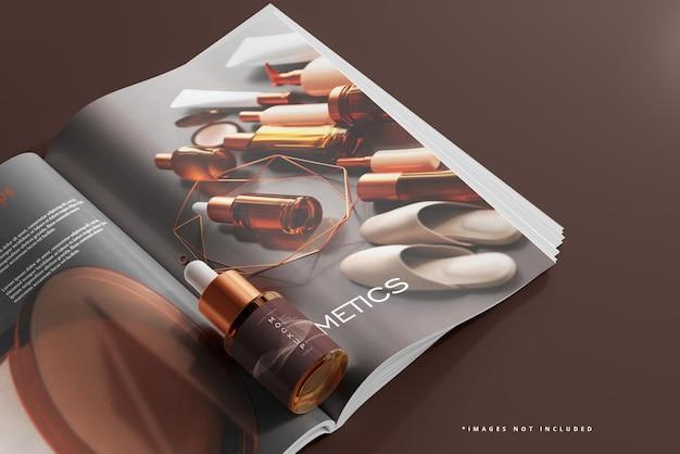 琥珀色のガラススポイトボトルと雑誌のモックアップ