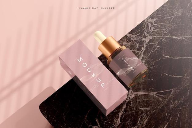Amber glass dropper bottle and box mockup
