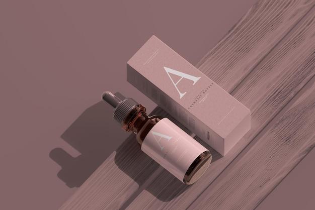 상자 모형이있는 앰버 유리 점 적기 병
