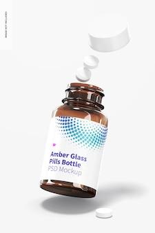 Мокап бутылки с таблетками из янтарного стекла, падающий
