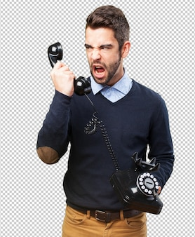 Angry man shouting to telephone