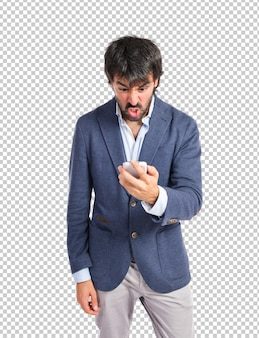 Angry man talking to mobile over white background