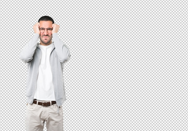 Angry young man posing against transparent surface