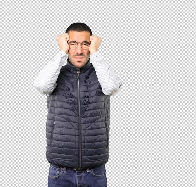Angry young man posing