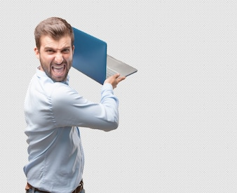 Angry young man with laptop
