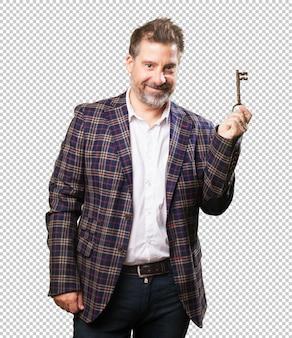 Architect man holding an old key