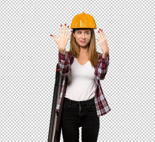 Architect woman counting eight with fingers