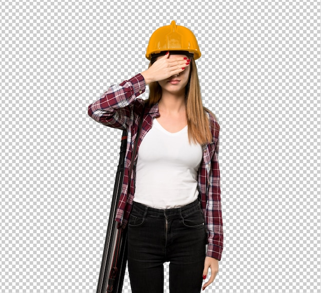 Architect woman covering eyes by hands. do not want to see something
