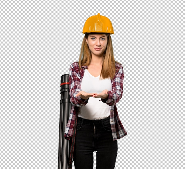 Architect woman holding copyspace imaginary on the palm to insert an ad