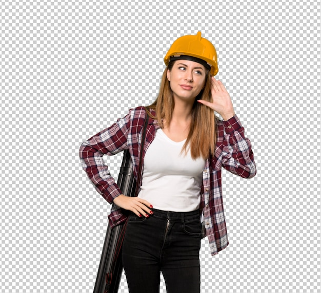 Architect woman listening to something by putting hand on the ear